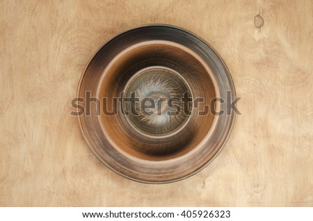 Home Kitchen Decor: the ceramic plates on a wooden background. Top view. Rustic style. - stock photo