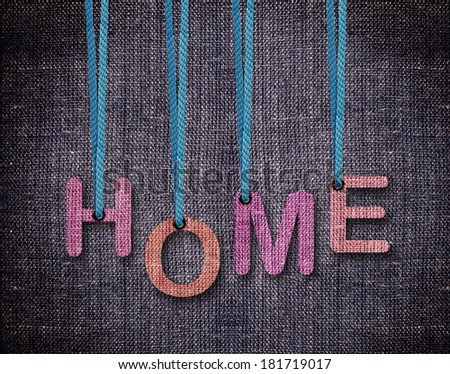 Home Letters hanging strings with blue sackcloth background. - stock photo