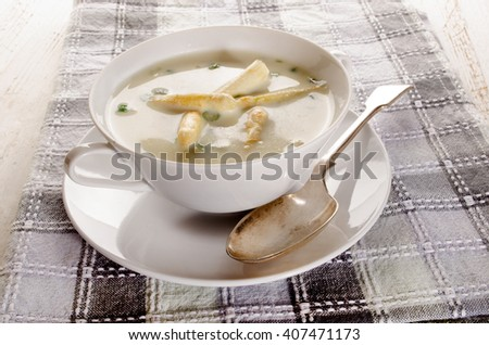 home made asparagus cream soup in a bowl - stock photo