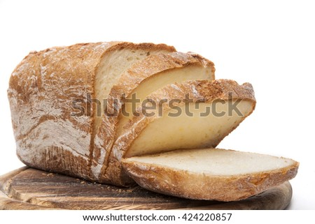 Home made Bread Sliced on wood and white background - stock photo