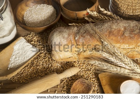 Home made bread, wheat and kitchen utensils - stock photo