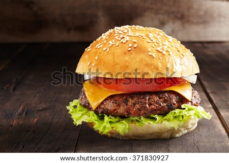 home made burger on a burned wooden background  - stock photo