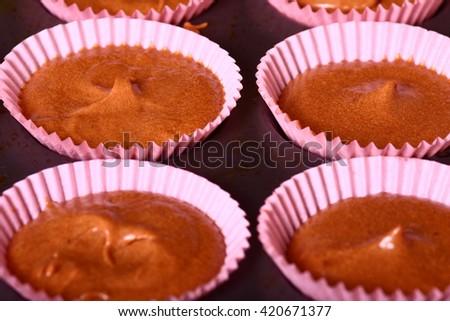 home made cake mixture in a bun case - stock photo
