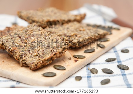 Home made crispbread with sesame and sunflower seeds - stock photo