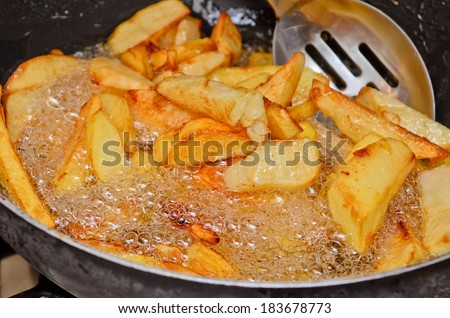 Home made deep fried chips. - stock photo