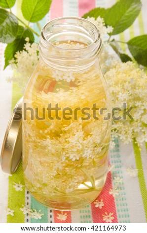 home made elderflower vinegar in a glass  bottle - stock photo