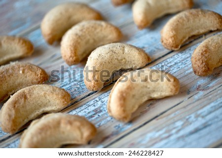 Home-made fresh baked vanilla cookies on table - stock photo