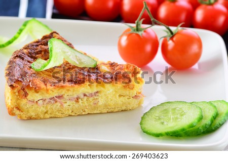 Home made ham and cheese quiche with tomatoes and cucumber   - stock photo