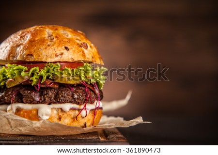 Home made hamburger with lettuce and cheese - stock photo