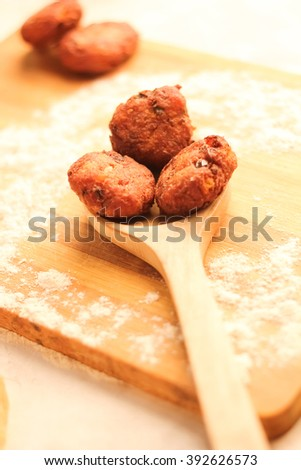 Home made healthy desi snack made of potato and onion - tikki/cutlet on wooden spoon  - stock photo