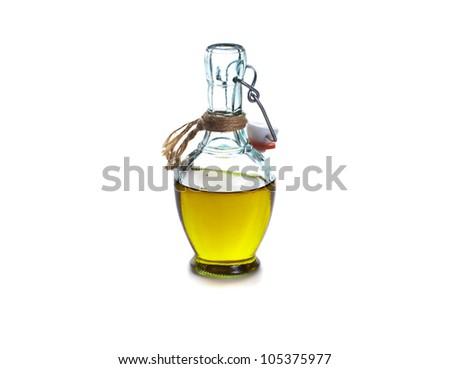 Home made olive oil in a glass bottle over white background, isolated - stock photo