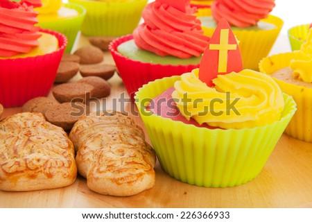 Home made Sinterklaas cupcakes with pepernoten and meringue - stock photo