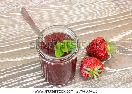 Home made strawberry jam with fresh fruits - stock photo
