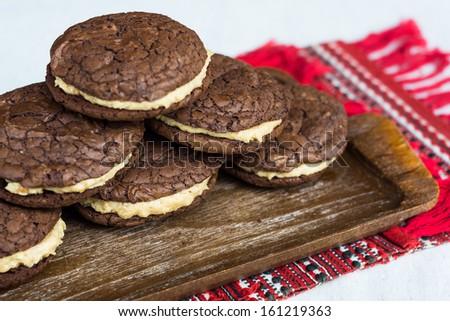 Home made stuffed chocolate cookies with peanut cream - stock photo