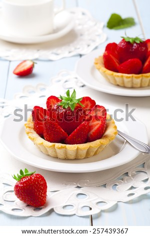 Home made tartlets with strawberries - stock photo