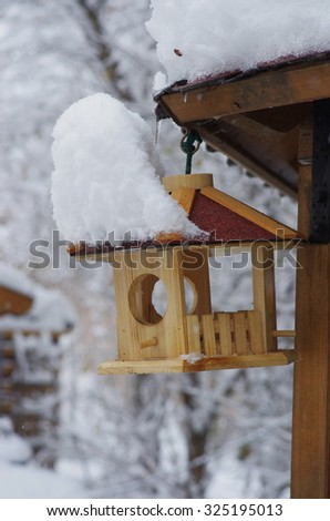 Home made wooden bird house on a tree. - stock photo