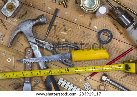 Home maintenance - An untidy workshop bench full of dusty old tools and screws. - stock photo