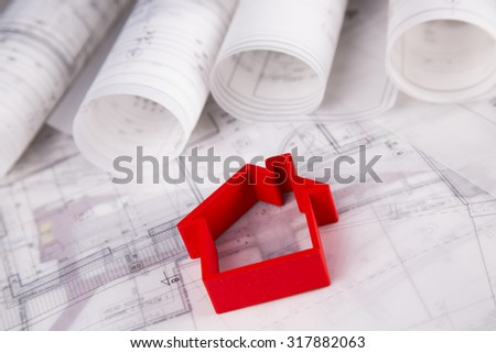 Home model with blueprint drawing - stock photo