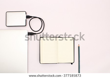 Home office background with laptop, notebook and external hard drive. - stock photo