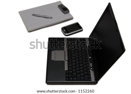 Home office setup - laptop, PDA, paper isolated on white - stock photo