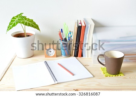 Home office table with stationary and coffee - stock photo