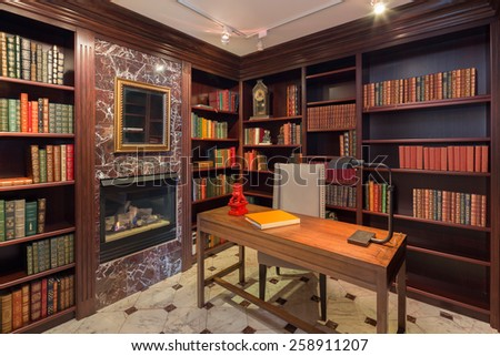 Home office with marble and wooden desk. - stock photo