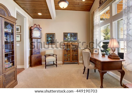 Home office with vintage furniture, carpet floor and beige walls - stock photo