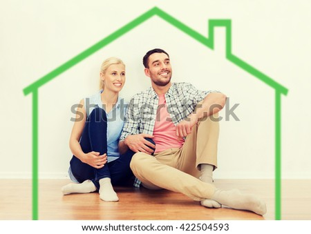 home, people, accommodation, moving and real estate concept - happy couple of man and woman sitting on floor at new place - stock photo