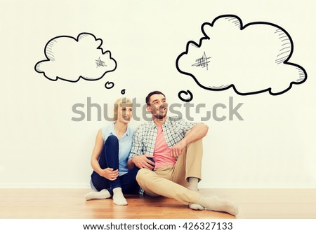 home, people, repair, moving and real estate concept - happy couple of man and woman sitting on floor at new place with empty blank text bubbles - stock photo