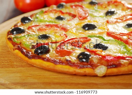 home pizza m paprika and olive Closeup .Shallow depth-of-field - stock photo