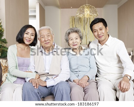 home portrait of a happy asian family - stock photo