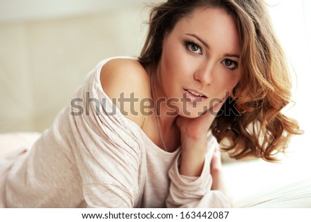 Home portrait of beautiful young woman, selective soft focus - stock photo