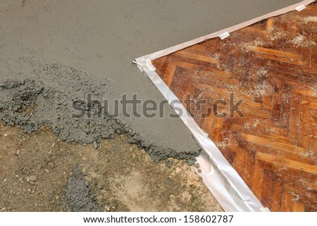 Home renovation, gravel concrete and parquet - stock photo