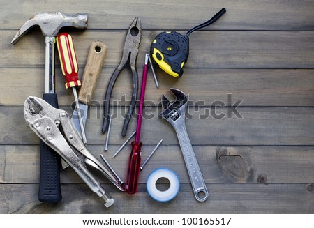 home renovation in progress. various tools against wooden surface, add your text. - stock photo