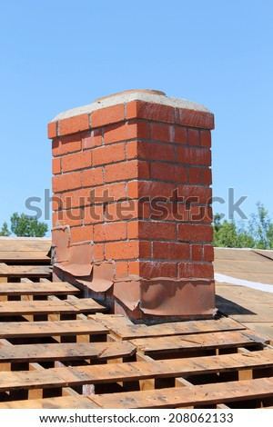 Home Roof Construction Site. Removal of old roof and replacement with all new materials. Roofs are an important part of any home, keeping it safe and dry from the elements and nosy neighbors. - stock photo