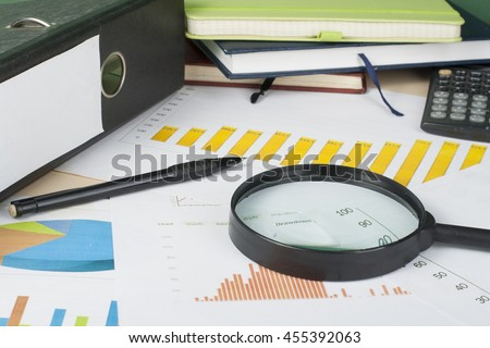 Home savings, budget concept. Chart, notepad, pen, calculator and coins on wooden office desk table - stock photo