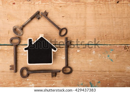 home security concept - little house and old keys - stock photo