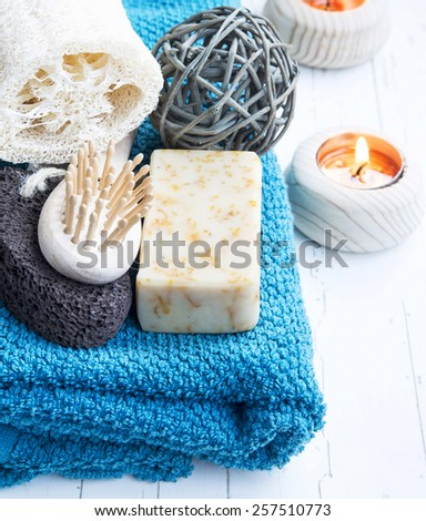 Home-Spa Products with Cotton Towel,Pumice and Body Brush, Natural Soap and Burning Candle  - stock photo