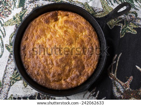 Home Style corn bread in a cast-iron skillet. - stock photo