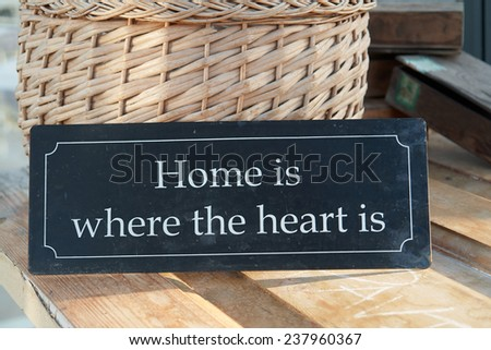 Home sweet home where the heart is text on a vintage metal sign                                - stock photo