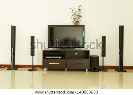 Home theater and white wall - stock photo