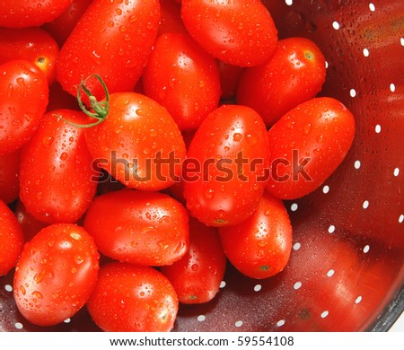 homegrown fresh grape tomatoes in a colander - stock photo
