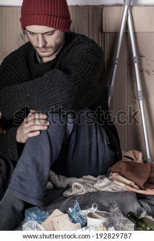 Homeless and depressed man on the street - stock photo