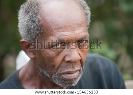 Homeless elderly african american man outside during the day - stock photo