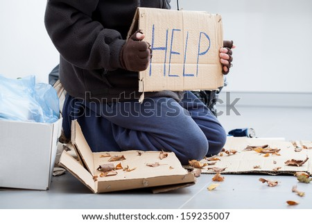 Homeless man on a street begging for benefit - stock photo