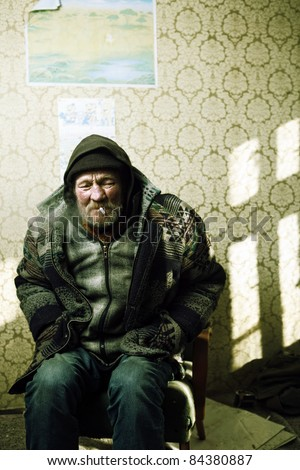 homeless man smoking Cigarette - stock photo
