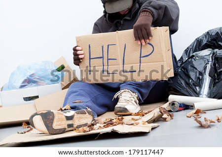 Homeless man with a cardboard asking for a help - stock photo