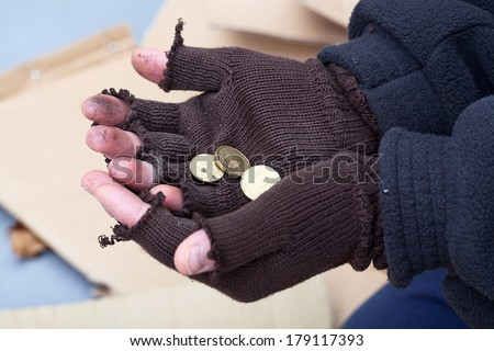 Homeless mans stretching out hands for a money - stock photo