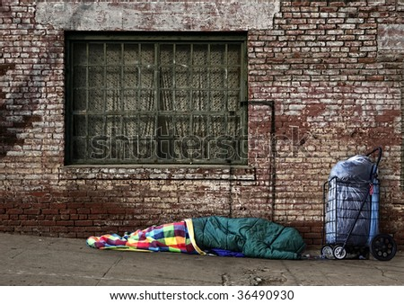 Homeless Soul Sleeping on the Streets in a Sleeping Bag Outdoors - stock photo