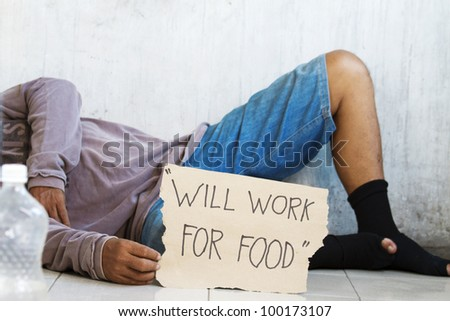 Homeless, unemployed and  hungry begging for food - stock photo